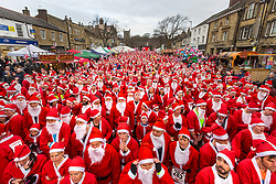 © Licensed to London News Pictures. 25/11/2018. Skipton UK. Over 1800 runners dressed as Santa are taking part in the Great Skipton Santa fun run today in the Yorkshire town of Skipton. The Annual event see's people dressed as father Christmas running a 5km route through the streets of Skipton in support of local charities. Photo credit: Andrew McCaren/LNP