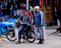 Two men chatting in a market square in the medina in Marrakech, Morocco, North Africa<br /> <br /> (c) Andrew Wilson | Edinburgh Elite media