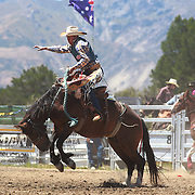 Sam Taylor, Australia, in action during the Open Saddle Bronc at the Wanaka Rodeo. Wanaka, South Island, New Zealand. 2nd January 2012