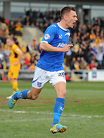 Portsmouth's Jed Wallace celebrates scoring his sides second goal <br /> <br /> Photo by Kevin Barnes/CameraSport<br /> <br /> Football - The Football League Sky Bet League Two - Newport County AFC v Portsmouth - Saturday 29th March 2014 - Rodney Parade - Newport<br /> <br /> © CameraSport - 43 Linden Ave. Countesthorpe. Leicester. England. LE8 5PG - Tel: +44 (0) 116 277 4147 - admin@camerasport.com - www.camerasport.com