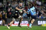 Luke Jacobson of the Chiefs fends off Will Harrison of the Waratahs during the Round 5 Trans-Tasman Super Rugby match between NSW Waratahs and Waikato Chiefs at Brookvale Oval in Sydney, Saturday, June 12, 2021. (AAP Image/Dan Himbrechts) NO ARCHIVING, EDITORIAL USE ONLY