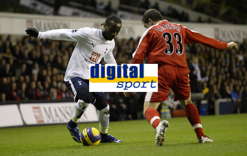 Photo: Marc Atkins.<br /> Tottenham Hotspur v Middlesbrough. The Barclays Premiership. 05/12/2006. Pascal Chimbonda (L) of Spurs in action with Andrew Taylor of Boro.