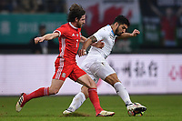 """Luis Suarez, right, of Uruguay national football team kicks the ball to make a pass against Joe Allen of Wales national football team in their final match during the 2018 Gree China Cup International Football Championship in Nanning city, south China's Guangxi Zhuang Autonomous Region, 26 March 2018.<br /> <br /> Edinson Cavani's goal in the second half helped Uruguay beat Wales to claim the title of the second edition of China Cup International Football Championship here on Monday (26 March 2018). """"It was a tough match. I'm very satisfied with the result and I think that we can even get better if we didn't suffer from jet lag or injuries. I think the result was very satisfactory,"""" said Uruguay coach Oscar Tabarez. Wales were buoyed by a 6-0 victory over China while Uruguay were fresh from a 2-0 win over the Czech Republic. Uruguay almost took a dream start just 3 minutes into the game as Luis Suarez's shot on Nahitan Nandez cross smacked the upright. Uruguay were dealt a blow on 8 minutes when Jose Gimenez was injured in a challenge and was replaced by Sebastian Coates. Inter Milan's midfielder Matias Vecino of Uruguay also fired at the edge of box from a looped pass but only saw his attempt whistle past the post. Suarez squandered a golden opportunity on 32 minutes when Ashley Williams's wayward backpass sent him clear, but the Barca hitman rattled the woodwork again with goalkeeper Wayne Hennessey well beaten."""