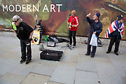 Gaz Stanley and the Piccadilly Rats street performance as a strange blend of robotic dance and music modern art outside the National Gallery in Trafalgar Square in London, England, United Kingdom. The group are Manchester based street artists.