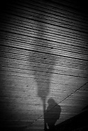 France. Paris. 1st district. pedestrian shadow on the pont des arts on the Seine river   / le pont des arts sur la Seine