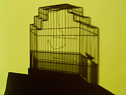 silhouette of an empty birdcage