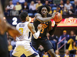 Jan 12, 2019; Morgantown, WV, USA; Oklahoma State Cowboys guard Isaac Likekele (13) looks to pass during the first half against the West Virginia Mountaineers at WVU Coliseum. Mandatory Credit: Ben Queen-USA TODAY Sports
