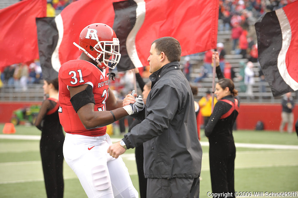 Dec 5, 2009; Piscataway, NJ, USA; Rutgers head coach Greg Schiano shakes hands with defensive end George Johnson during the senior ceremony before first half NCAA Big East college football action between Rutgers and West Virginia at Rutgers Stadium.