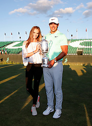 Brooks Koepka of the United States poses with the winner's trophy with Jena Sims after his victory at the 2017 U.S. Open. 18 Jun 2017 Pictured: Brooks Koepka with Jena Sims. Photo credit: MEGA TheMegaAgency.com +1 888 505 6342