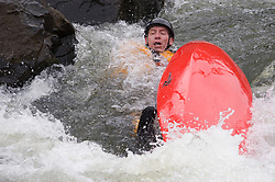 Tom McGregor of Madison, Wisconsin races in the C1 men's plastic class during the slalom course of the 42nd Annual Missouri Whitewater Championships. McGregor did not finish his run after he overturned. The Missouri Whitewater Championships, held on the St. Francis River at the Millstream Gardens Conservation Area, is the oldest regional slalom race in the United States.