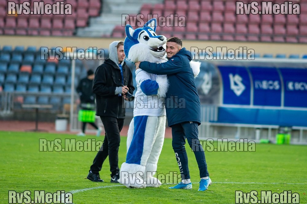 LAUSANNE, SWITZERLAND - NOVEMBER 10: #9 Andi Zeqiri of FC Lausanne-Sport celebrates team victory with Mascot Loupo after the Challenge League game between FC Lausanne-Sport and FC Schaffhausen at Stade Olympique de la Pontaise on November 10, 2019 in Lausanne, Switzerland. (Photo by Monika Majer/RvS.Media)