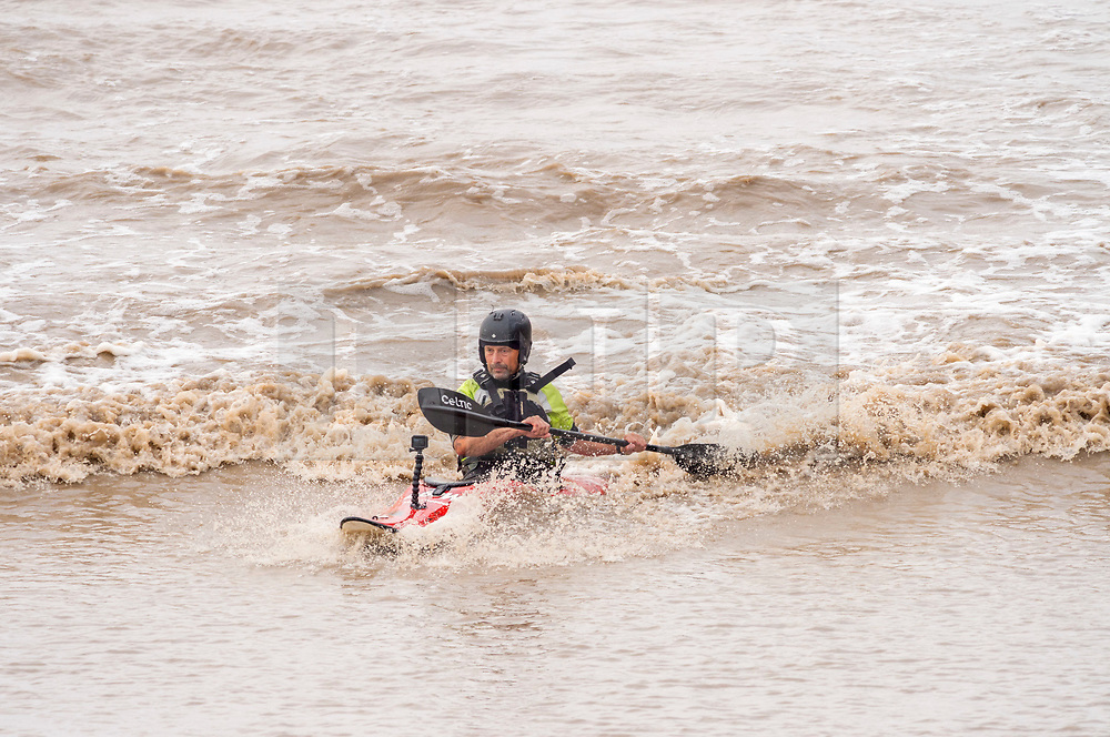 © Licensed to London News Pictures; 20/09/2020; Newnham, Gloucestershire, UK. Surfers ride the Severn Bore on Sunday morning. The Severn Bore is a tidal surge on the river Severn which is formed because the Severn Estuary has the second highest tidal range in the world. Photo credit: Simon Chapman/LNP.