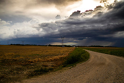 A wall cloud and thunderstorm clouds pass over the farm fields of Central Illinois in late spring