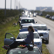 Paula Rankin who drove down from Gainesville, Georgia sits on her automobile in preparation for a SpaceX Falcon Heavy rocket test from the Kennedy Space Center on Tuesday, February 6 2018 in Titusville, Florida. The high-power launcher also boosted Elon Musk's electric Tesla sportswear into deep space. (Alex Menendez via AP)