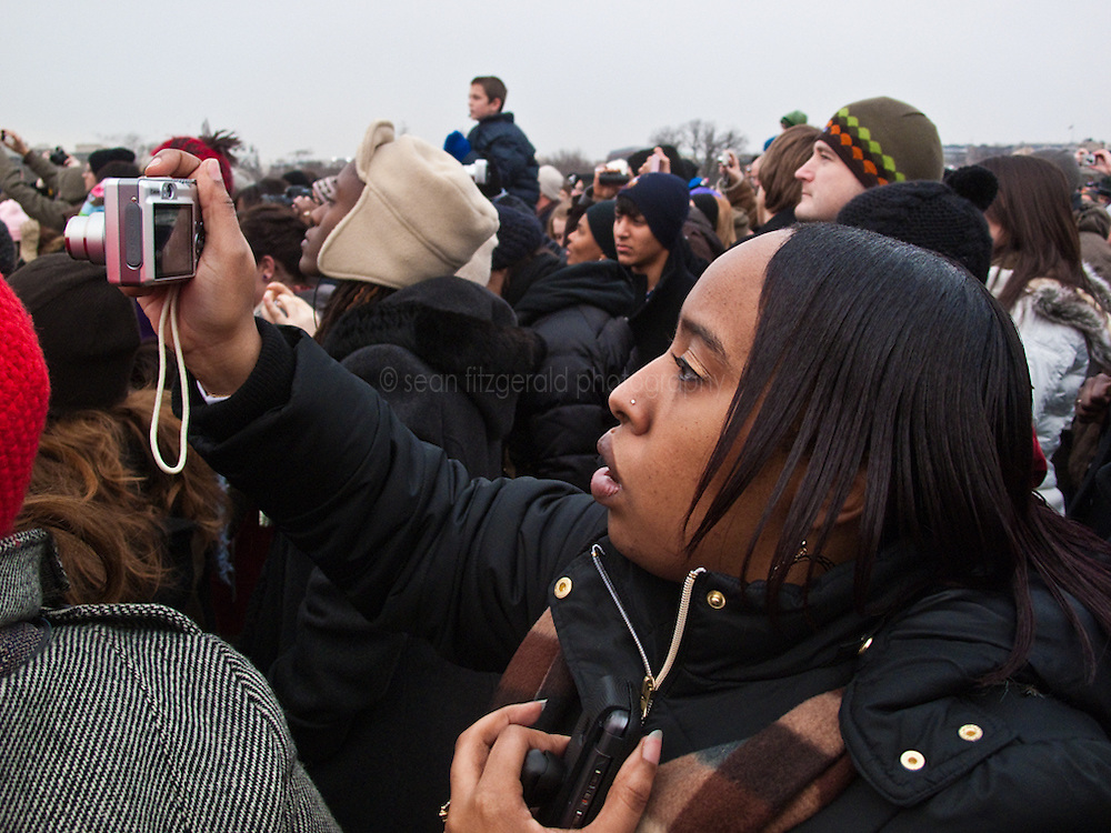 Audience members taking photographs at Inaugural Concert for Barack Obama, the Mall, Washington D.C., USA.