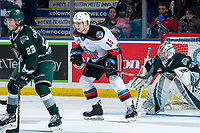 KELOWNA, BC - FEBRUARY 28: Jake Christiansen #23. looks for the pass as Dustin Wolf #32 of the Everett Silvertips defends the net behind Dallon Wilton #15 of the Kelowna Rockets at Prospera Place on February 28, 2020 in Kelowna, Canada. (Photo by Marissa Baecker/Shoot the Breeze)