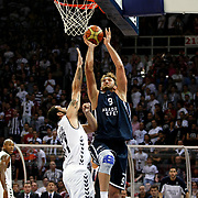 Besiktas's Cevher Ozer (L) and Anadolu Efes's Semih Erden (R) during their 28. Men's Basketball Presidential Cup match Besiktas between Anadolu Efes at the Abdi ipekci Arena in Istanbul Turkey on Sunday 30 September 2012. Photo by TURKPIX