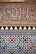 Arabesque Zellighe tiles with Mudjar plasterwork of the Alcazar of Seville, Seville, Spain . The Royal Alcázars of Seville (al-Qasr al-Muriq ) or Alcázar of Seville, is a royal palace in Seville, Spain. It was built by Castilian Christians on the site of an Abbadid Muslim alcazar, or residential fortress.The fortress was destroyed after the Christian conquest of Seville The palace is a preeminent example of Mudéjar architecture in the Iberian Peninsula but features Gothic, Renaissance and Romanesque design elements from previous stages of construction. The upper storeys of the Alcázar are still occupied by the royal family when they are in Seville. <br /> <br /> Visit our SPAIN HISTORIC PLACES PHOTO COLLECTIONS for more photos to download or buy as wall art prints https://funkystock.photoshelter.com/gallery-collection/Pictures-Images-of-Spain-Spanish-Historical-Archaeology-Sites-Museum-Antiquities/C0000EUVhLC3Nbgw <br /> .<br /> Visit our MEDIEVAL PHOTO COLLECTIONS for more   photos  to download or buy as prints https://funkystock.photoshelter.com/gallery-collection/Medieval-Middle-Ages-Historic-Places-Arcaeological-Sites-Pictures-Images-of/C0000B5ZA54_WD0s
