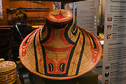 A hat (Xaadas) made of split spruce roots with painted clan crest by late 1800s Haida Gwaii. Alaska State Museum, Juneau. The City and Borough of Juneau is the capital city of Alaska and the second largest city in the USA by area (only Sitka is larger). This unified municipality lies on Gastineau Channel in the Alaskan panhandle. Juneau has been the capital of Alaska since 1906, when the government of what was the District of Alaska was moved from Sitka. The city is named after a gold prospector from Quebec, Joe Juneau. Isolated by rugged terrain on Alaska's mainland, Juneau can only be reached by plane or boat. Downtown Juneau sits at sea level under steep mountains up to 4000 feet high, topped by Juneau Icefield and 30 glaciers.