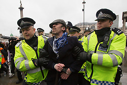 © licensed to London News Pictures. London, UK 13/04/2013. A man being arrested as a group of people gathering in Trafalgar Square to celebrate the death of former Prime Minister Margaret Thatcher's death on Saturday, 13 April 2013. Photo credit: Tolga Akmen/LNP