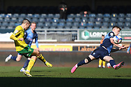 Norwich City midfielder Emiliano Buendia (17) takes a shot at goal under pressure from Wycombe Wanderers defender (on loan from Leicester City) Josh Knight (12) during the EFL Sky Bet Championship match between Wycombe Wanderers and Norwich City at Adams Park, High Wycombe, England on 28 February 2021.