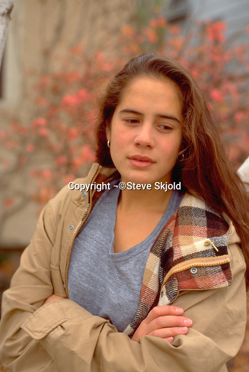 Tongan American college student age 18 reflecting in autumn day.  St Paul Minnesota USA