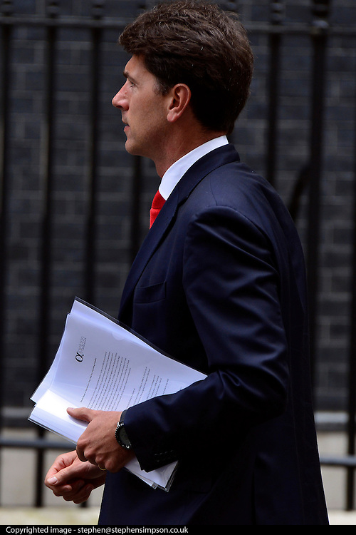 © Licensed to London News Pictures. 11/06/2013. CITY/TOWN e.g Windsor, UK A man carries papers about the Royal Bank of Scotland on Downing Street today 11 June 2013. Photo credit : Stephen Simpson/LNP