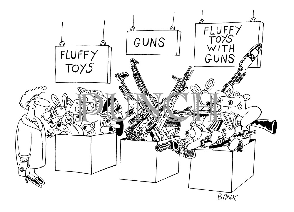 (Woman in shop looking at toy bins marked: Fluffy Toys, Guns and Fluffy Toys with Guns)