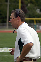 11 September 2004   IWU Head Coach Norm Eash checks his roster and play card.   Illinois Wesleyan University V University of Wisconsin - Eau Claire Division III Football, Wilder Field, IWU, Bloomington, IL
