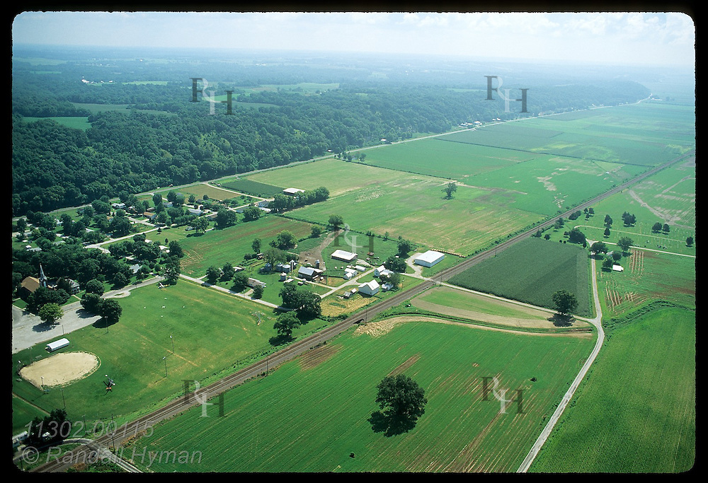 Farms stretch into distance along base of Mississippi River bluffs in August; Prairie du Rocher Illinois