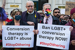 London, UK. 23rd June, 2021. Campaigners against LGBT+ conversion therapy, including Jayne Ozanne of the Ban Conversion Therapy Coalition (l) and veteran LGBT+ and human rights activist Peter Tatchell (r), attend a picket outside the Cabinet Office and Government Equalities Office. They also handed in a petition signed by 7,500 people calling on the government to fulfil its 2018 promise to ban LGBT+ conversion therapy.