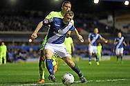 Birmingham City defender Paul Caddis (31) and Brighton striker, Tomer Hemed (10) during the Sky Bet Championship match between Birmingham City and Brighton and Hove Albion at St Andrews, Birmingham, England on 5 April 2016.
