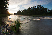 Sunrise at the river Allier at Pont-du-Chateau, Auvergne, France.