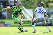 Forest Green Rovers Carl Winchester(7) takes on Colchester United's Ben Stevenson(24) during the EFL Sky Bet League 2 match between Forest Green Rovers and Colchester United at the New Lawn, Forest Green, United Kingdom on 14 September 2019.