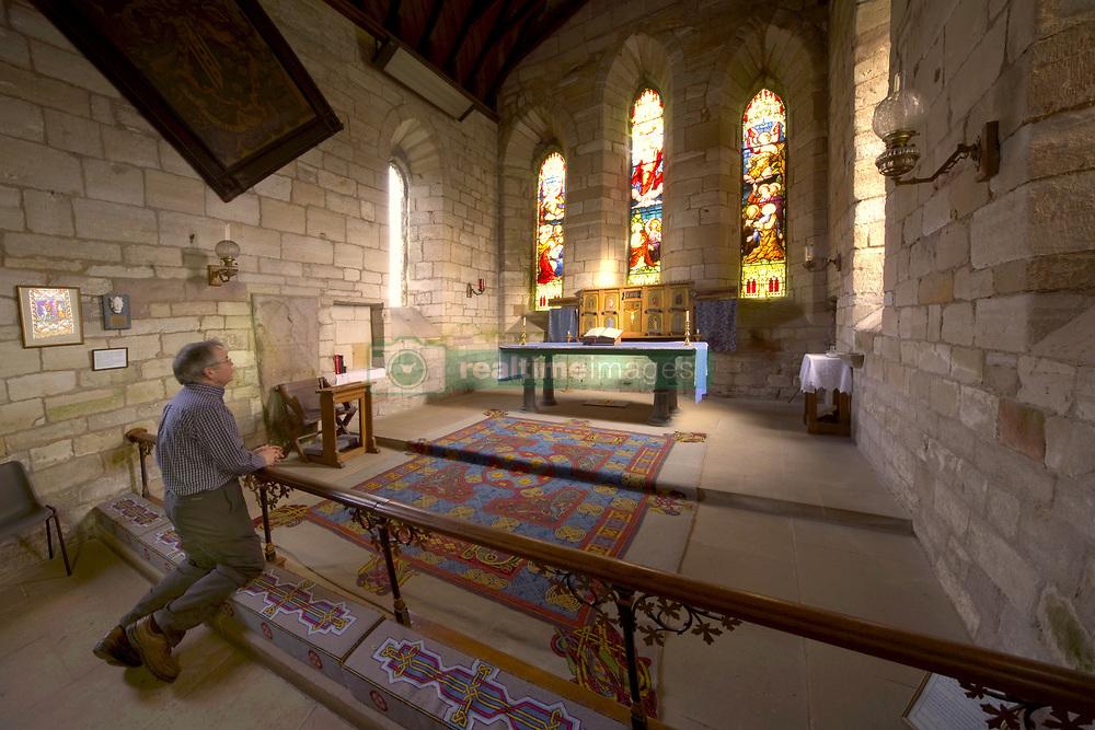July 21, 2019 - Man Praying In Chapel, Holy Island, Bewick, England (Credit Image: © John Short/Design Pics via ZUMA Wire)
