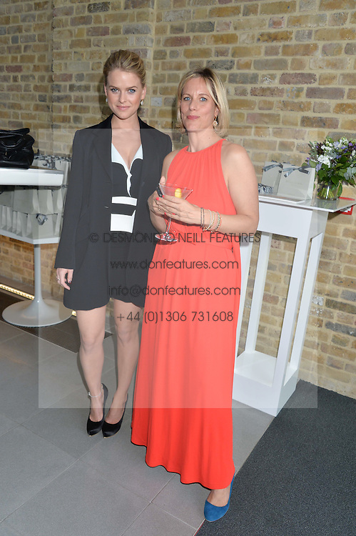 Left to right, ALICE EVE and BEC ASTLEY CLARKE at a summer drinks party hosted by Bec Astley Clarke at the Serpentine Sackler Gallery, Hyde Park, London on 17th June 2014.