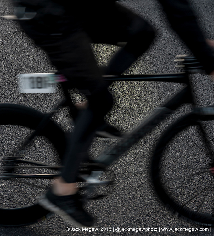 Riders warm up by doing laps around a car park before the Red Hook Crit on the Greenwich Peninsular, London. July 12, 2015.