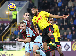 Watford's Adrian Mariappa (right) and Burnley's Scott Arfield battle for the ball during the Premier League match at Turf Moor, Burnley.