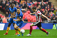 Shaun Whalley of Shrewsbury Town (7) and Lee Frecklington of Lincoln City (19) battle for the ball during the EFL Trophy Final match between Lincoln City and Shrewsbury Town at Wembley Stadium, London, England on 8 April 2018. Picture by Stephen Wright.
