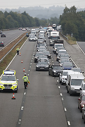 """© Licensed to London News Pictures. 14/08/2020. Esher, UK. The scene of an incident on the A3 near Esher in Surrey where a vehicle involved in a police chase collided with traffic while travelling in the wrong direction. A """"number of patients"""" are being treated by ambulance crews. Photo credit: Peter Macdiarmid/LNP"""