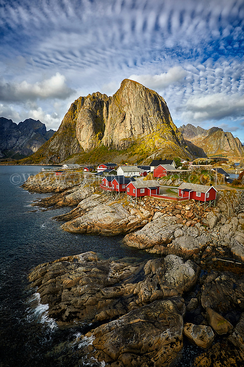 Sun sets on the fishing village of Hamnoy in the Lofoten Islands of Norway.