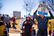 23 JANUARY 2011 - PHOENIX, AZ:  A man with a pro-life sign listens to anti-abortion speakers during the March for Life through Phoenix, AZ, Sunday. About 500 people participated in the pro-life march and rally, which marked the 38th anniversary of the US Supreme Court's Roe vs. Wade decision, which legalized abortion in the United States.  PHOTO BY JACK KURTZ