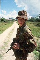 British soldier private James Burgess from Wigan serving with the A Company of The Queens Regiment seen on patrol in Belize in 1981.After Belize achieved independence in 1981 the United Kingdom maintained the deterrent British Forces Belize in the country to protect it from invasion by Guatemala. Ever since it has been used as a jungle warfare training centre with access to over 5000 square miles of land. Photograph by Terry Fincher