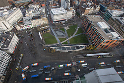 © Licensed to London News Pictures . 07/12/2013 . Piccadilly Gardens and central Manchester's main tram and bus interchange . Cityscape view of Manchester . Photo credit : Joel Goodman/LNP