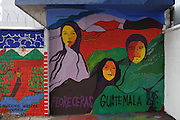 Mural painted by the H.I.J.O.S. collective on the fence surrounding the Historic National Police Archives in Guatemala City pictures from left to right: Rogelia Cruz, María del Rosario Godoy de Cuevas & Efraín Bámaca (aka Comandante Everardo), three well-known wartime victims. On July 5, 2005, the historical archives of the now dissolved National Police were found in an abandoned arms depot in the outskirts of Guatemala City. The discovery of these millions of documents, which were allegedly lost after the 1996 Peace Accords, provide important evidence in the search for the thousands of people who were detained and subsequently disappeared by State security forces during the internal armed conflict (1960-1996). Guatemala City, Guatemala. December 13, 2011.