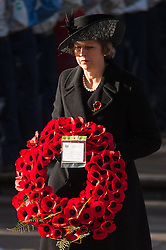 Prime Minister Theresa May prepares to lay a wreath during the annual Remembrance Sunday Service at the Cenotaph memorial in Whitehall, central London, held in tribute for members of the armed forces who have died in major conflicts.