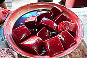 Pig blood in the Phousy public market in Ban Saylom Village, just south of Luang Prabang, Laos.