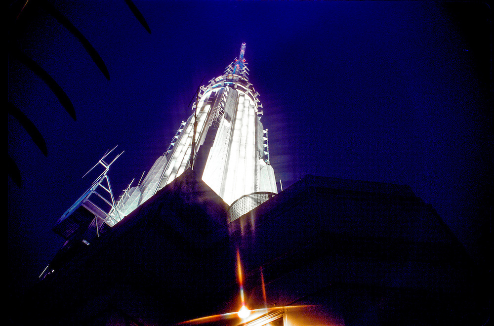 The Empire State Building's illuminated, Art Deco spire, viewed at night from the building's 86th-floor Observation Deck. A second, higher Observatory is in the tower itself, at the 102nd floor.