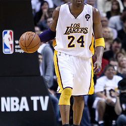 March 10, 2011; Miami, FL, USA; Los Angeles Lakers shooting guard Kobe Bryant (24) against the Miami Heat during the second quarter at the American Airlines Arena.  Mandatory Credit: Derick E. Hingle