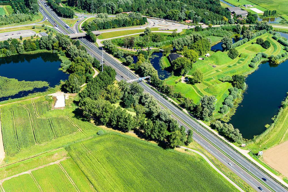 Nederland, Noord-Brabant, Werkendam, 23-08-2016; Fort Altena, onderdeel van de Nieuwe Hollandse Waterlinie. Rijksweg A27 gaat door een deel van de verdedigingswerken. Het torenfort is gebouwd rond 1850, sinds 2001 eigendom van Stichting Brabants Landschap en tegenwoordig in gebruik voor recreative doeleinden, zoals bijvoorbeeld bedrijfsuitjes.<br /> Fort Altena, part of the New Dutch Waterline. Main road A27 passes through some of the defense works.<br /> <br /> aerial photo (additional fee required); <br /> luchtfoto (toeslag op standard tarieven); copyright foto/photo Siebe Swart